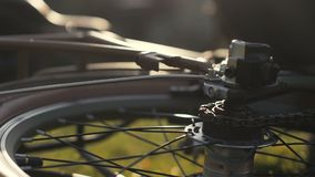 Bicycle wheels lying on green grass close up. Bicycle lying on grass stock video