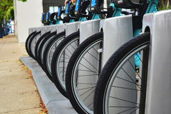 Bicycle wheels. Row of front wheels at parking for rent royalty free stock images