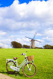 Bicycle and windmill. Bicycle travel concept. Royalty Free Stock Photo