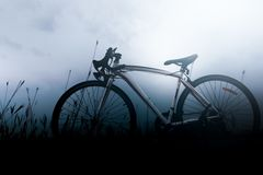 Bicycle on winter cloud sky. Bicycle on meadow and winter cloud sky in the background Royalty Free Stock Photography
