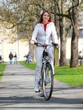 Bicycle and woman Royalty Free Stock Images