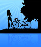 Bicycle and women Stock Photography