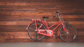 Bicycle. And wood texture background Stock Image