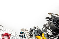 Bicycle workshop spares and tools. Mountain bike spares  cassette bolts chain skewers brake disk rotors levers tube sprockets and tools allen keys cable cutter Royalty Free Stock Image