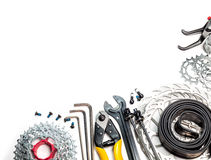Bicycle workshop spares and tools. Mountain bike spares  cassette gear skewers brake disk rotors levers tube sprockets and tools allen keys cable cutter on white Stock Images