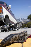 Bicycle Wreck Scene. An accident scene of a shoe laying in the road in front of a bmx bicycle that has been crushed under a van, with the city of San Francisco stock images