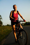 Bicycler. The smile girl with a bicycle Royalty Free Stock Photography
