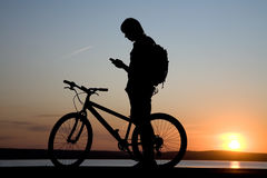 Bicycler call  by phone Royalty Free Stock Photography