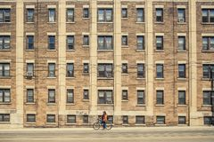 Bicycler on city streets Stock Photo