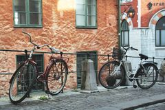 Bicycles. Two bicycles by the wall Royalty Free Stock Images