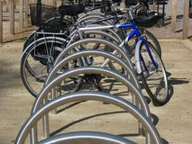 Bicycles. Bikes parked in a bike stand Royalty Free Stock Image