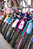 Bicycles. Row, custom bikes with colorful various patterns: flowers, flower power Royalty Free Stock Photo
