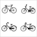 Bicycles. Four detailed bicycles black and white silhouettes Stock Photography