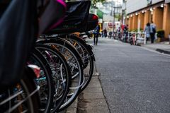 Bicycles along an alley in Shinjuku Stock Image