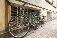 Bicycles along wall Stock Photos