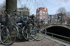 Bicycles in Amsterdam. Bicycles parked in front of a canal in Amsterdam Royalty Free Stock Images