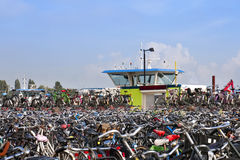 Bicycles in Amsterdam, Netherlands. Crowd of bicycles near the ferry station in Amsterdam, Netherlands Royalty Free Stock Images