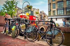 Bicycles on Amsterdam street on sunny summer day. Bicycles on Amsterdam street on sunny summer day Royalty Free Stock Photo