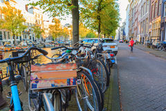 Bicycles with Amsterdams cityscape at sunset Royalty Free Stock Photo