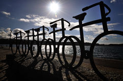 Bicycles as artform. Silhouette of statue of bicycles by the water Royalty Free Stock Photos