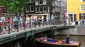 Bicycles attached to a bridge in Amsterdam  City of Amsterdam stock video