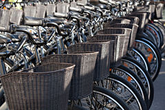 Bicycles with baskets  for rent docking station in Copenhagen, D Stock Photos