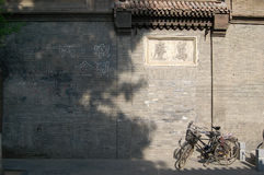 Bicycles Beside Old Wall Stock Photos