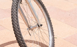 Bicycles. Bicycle wheel and its shadow on the concrete Stock Photography