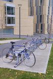 Bicycles in bike rack. Bicycles parked and locked in bike rack in front of buildings Stock Photography