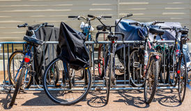 Bicycles and bikes rack. Covered and uncovered bicycles and bikes rack Royalty Free Stock Photography