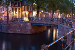 Bicycles on the bridge over an Amsterdam canal Royalty Free Stock Photo