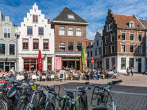 Bicycles and cafe terraces in Utrecht, Netherlands. Bicycles and people on outdoor terrace of cafes in Minrebroederstraat in the city of Utrecht, Netherlands Royalty Free Stock Photos