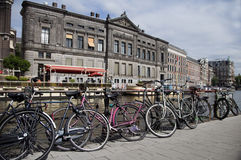 Bicycles on canal amsterdam holland Stock Photography