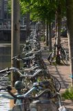 Bicycles at the canals in Amsterdam. Bicycles parked next to one of the famous Canals of Amsterdam, The Netherlands Royalty Free Stock Photo