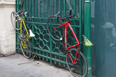 Bicycles chained to gate London Stock Image