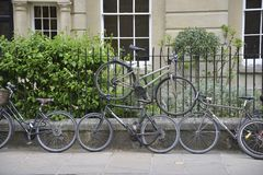 Bicycles chained to railings, Oxford stock photo