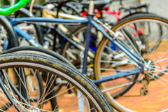 Bicycles at a crowded bike rack. Colorful Bicycles at a crowded city bike rack in front of an office building Stock Photography