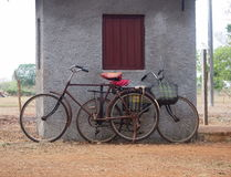 Bicycles Of Cuba. Old model bicycles with red seats against a grey wall Cuba Stock Photos