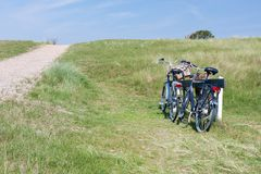 Bicycles in the dunes in Netherlands. Stock Photos