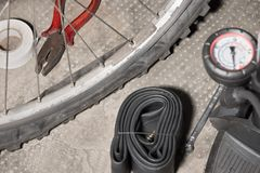 Bicycle with punctured flat tire. Concept of bad luck and unforeseen. Bicycles with flat tire and equipment to replace it royalty free stock image