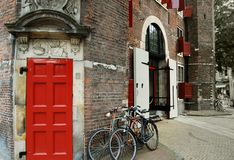 Bicycles in front of historic building, Amsterdam stock image
