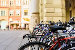 Bicycles at Graz city square. Buildings in the background.Bikes in foreground Stock Image