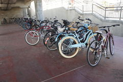 Bicycles. A group of Bicycles parked on the ground floor at the Huntington Beach Pier Stock Images