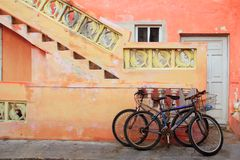 Bicycles on grunge tropical Caribbean facade Royalty Free Stock Photos