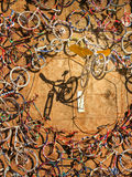 Bicycles hanging on the citadel wall at Calvi in Corsica Royalty Free Stock Photo