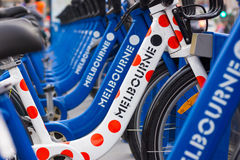 Bicycles for hire in the center of Melbourne, Australia. Brightly coloured bicycles for hire in Melbourne, Australia Royalty Free Stock Image