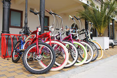 Bicycles for hire. Many multi-colored bicycles are rented for hire Royalty Free Stock Photo