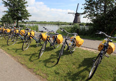 Bicycles in Holland. Bicycles and Windmills in central Holland, near Kinderdijk stock photography