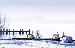 Bicycles at the lake shore, tranquil winter scenery Stock Photo