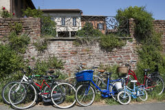 Bicycles leaning against a old brick wall Stock Photos